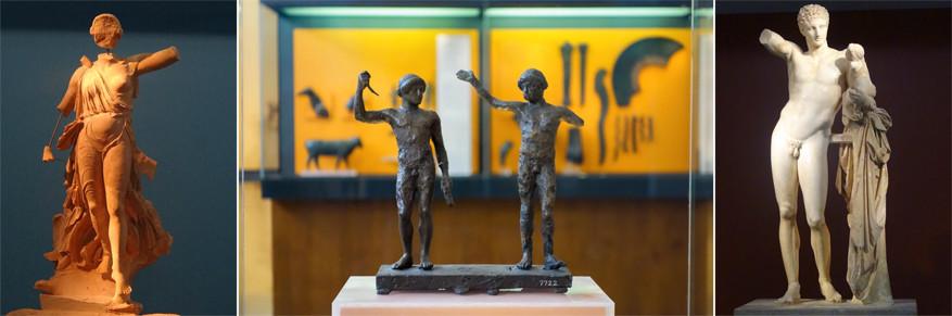 Nikè van Paionios links en Hermes van Praxiteles rechts in het Archeologisch Museum
