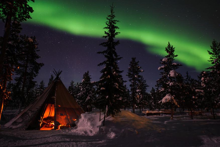 In Jukkasjärvi maak je grote kans het noorderlicht te spotten.